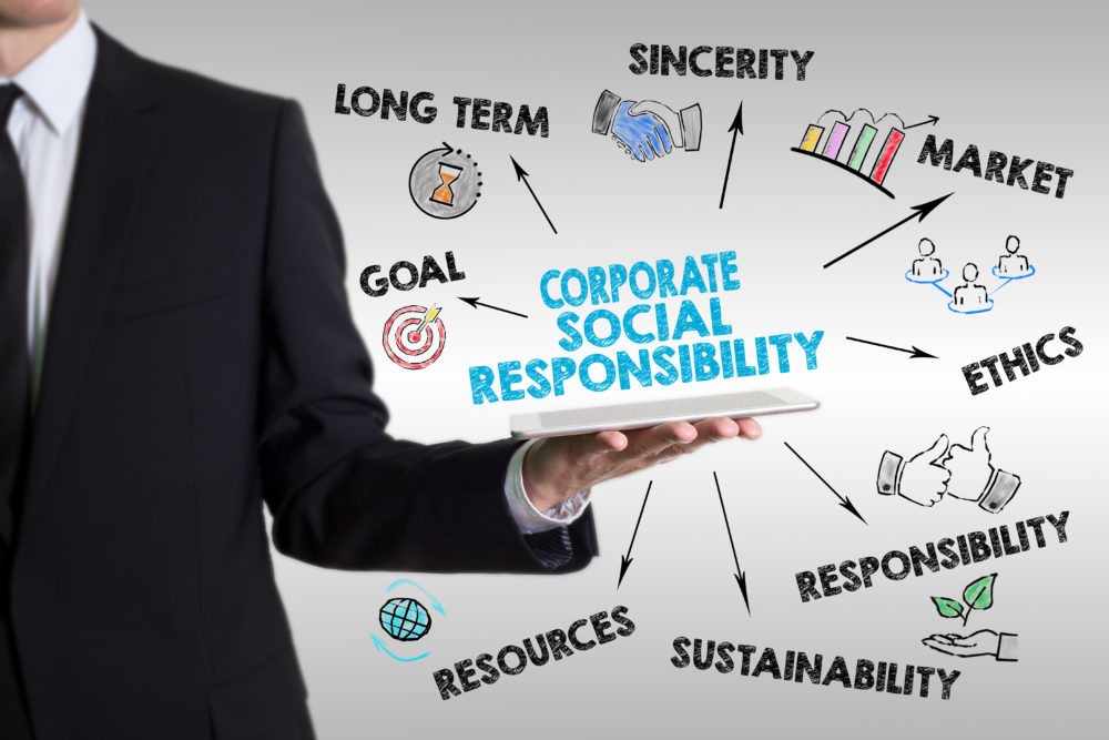 Corporate Social Responsibility Concept. Man holding a tablet co